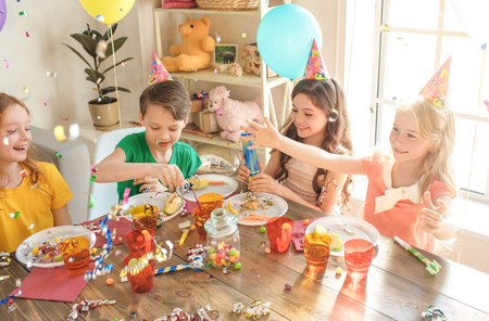 Little children celebrating birthday together at home