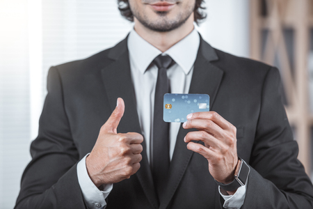 Male person working in the office business holding credit card Lizenzfreie Bilder