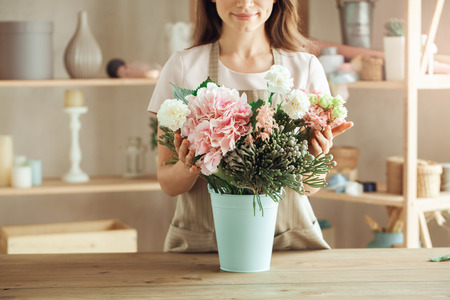 Young woman florist occupation working with flowers