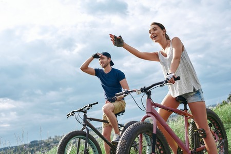 A happy couple on mountain bikes opens up new horizons.