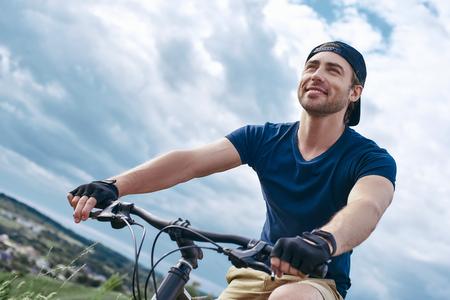 Joyful man, in active recreation on a mountain bike. Stock Photo