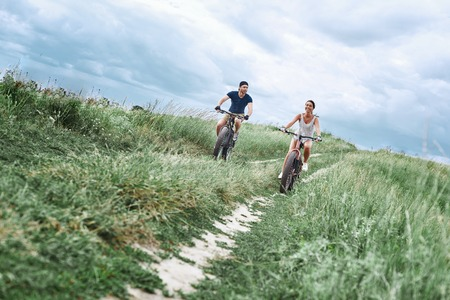 Fat bike also called fatbike or fat-tire bike in summer driving