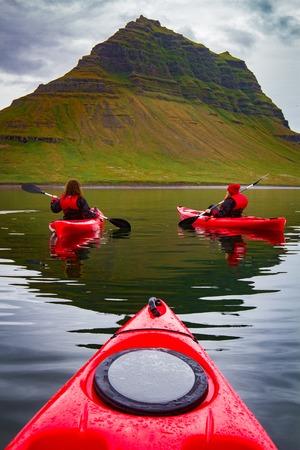 Extreme adventure sport, Iceland kayaking, paddling on kayak, outdoors activity Фото со стока