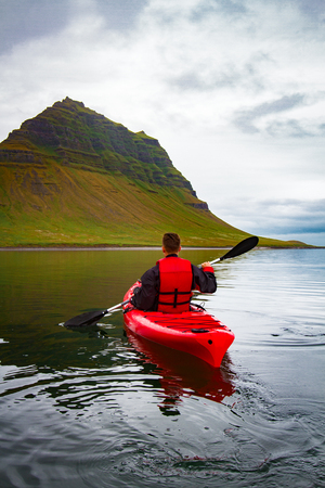 Extreme adventure sport, Iceland kayaking, paddling on kayak, outdoors activity Stock Photo