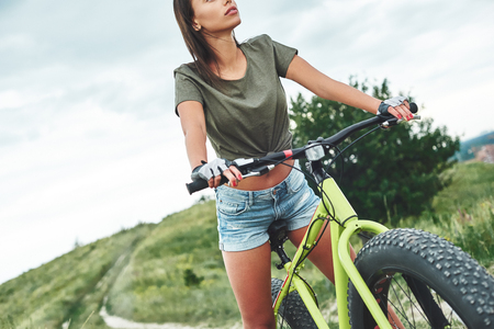 Young sexy woman on a bike. Cropped photo Stock Photo