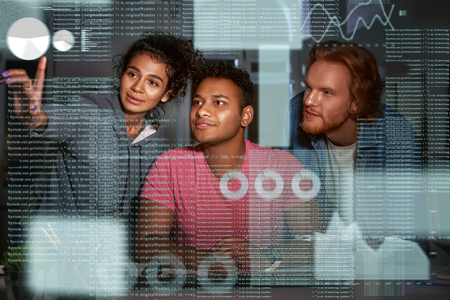Young team of data analysts are going through endless data streams