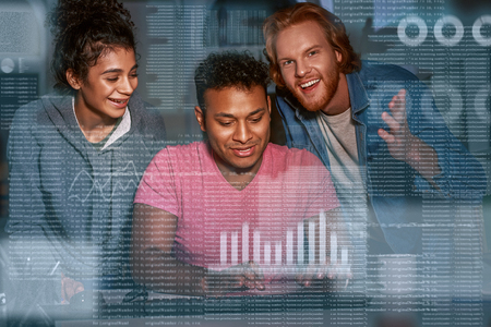 Young team of marketing department are working overtime on project Stock Photo
