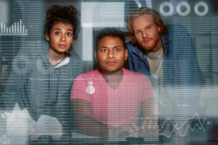 Young team of data analysts are looking over the data Stock Photo