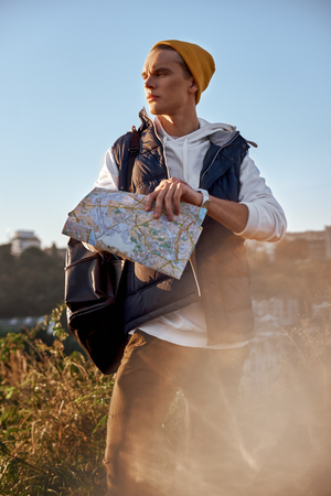 Young tourist blogger is exploring the map Stock Photo