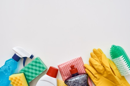 Cleaning tools. Spray bottle and other items isolated, cropped photo Stock Photo