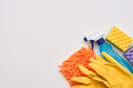 Cleaning tools. Spray bottle and other items isolated at the right corner Stock Photo