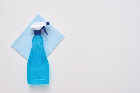 Cleaning tools. Spray bottle and blue cleaner cloth isolated Stock fotó