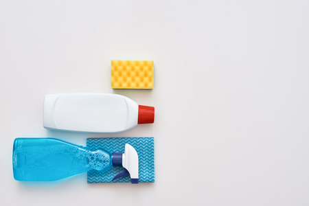 Cleaning tools. Spray bottle, orange cleaner sponge and cleanser isolated
