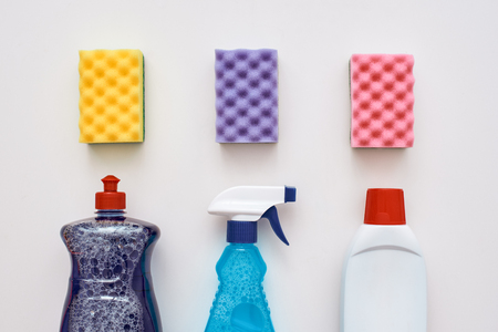 Three cleaning sponges and other tools isolated.