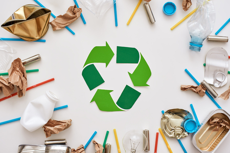 Garbage circle. Different types of garbage around the recycling symbol Banco de Imagens