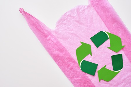 You can make this world better. Recycle symbol at pink plastic bag Stock Photo