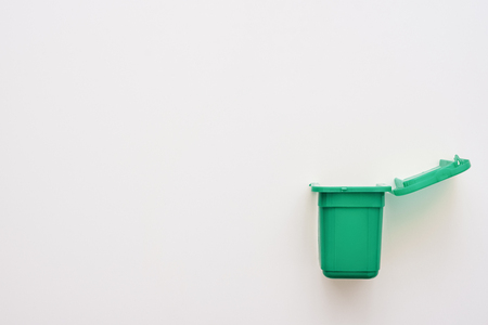 Recycling bio bin isolated. Green trash can isolated at white background