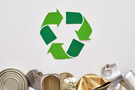 Protect the environment. Canned garbage, near recycle symbol Banco de Imagens