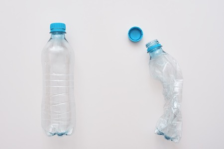 Dont scrum your world. Two plastic bottles, one is crumble Zdjęcie Seryjne