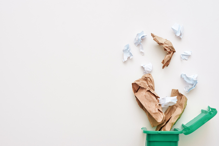 Cropped photo of paper trash. Crumple paper falling to the recycling bin Stock Photo - 114019121