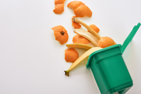 Cropped photo of organic garbage. Banana and orange peels, isolated Banco de Imagens - 114019144
