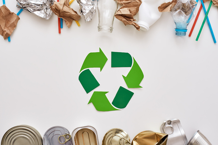 Save the world. Canned garbage, sorted separately near recycle symbol