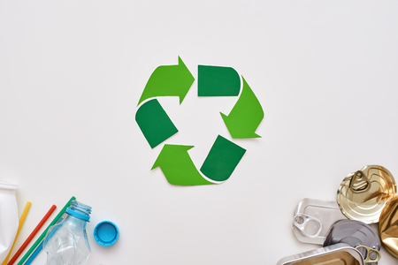Garbage sorting saves the world. Crumple canns and plastic at the corners