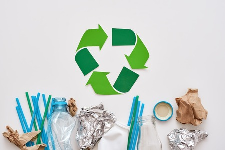 Garbage sorting saves the world. Crumple foil, paper and plastic Фото со стока