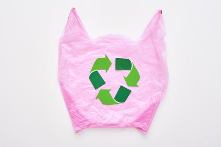 Save nature. Recycle symbol at pink plastic bag Stok Fotoğraf