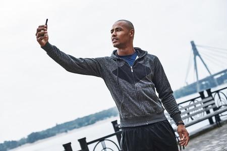 Morning run selfie. Muscular african male jogger Stock Photo - 114022283