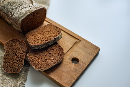 Sliced rustic dark food balance on the wooden desk at the table