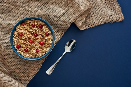 Fitness breakfast. Oatmeal with berries, nuts and honey
