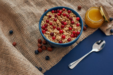 Fitness breakfast. Oatmeal with berries, nuts and honey Stock Photo - 114022728
