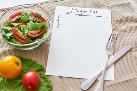 Diet list. Fresh vegetables are on the table