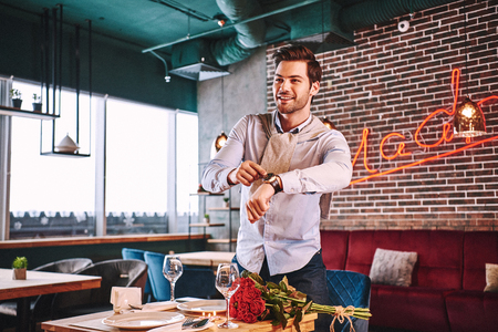 How could you being late. Man is trying to make order while waiting in restaurant Stock Photo