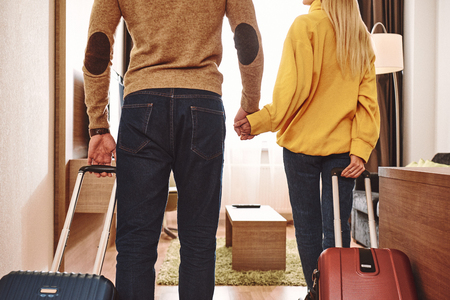 Vacation starts. Cropped couple checking in their holiday rental apartment Stock Photo