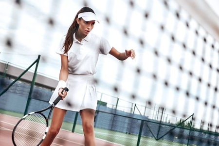 Never give up. Beautiful woman don`t want to miss the tennis ball during the match Banque d'images