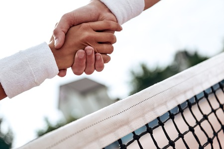 Respect. Tennis players are shaking hands