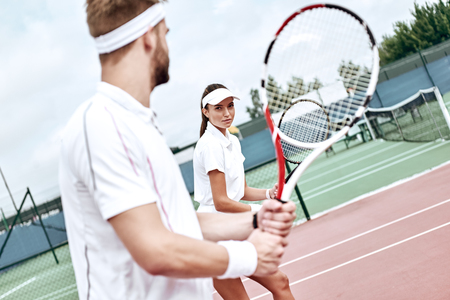 Active lifestyle. Couple is ready to play tennis