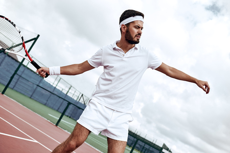Do your best. Tennis player prepares to hit the ball Stock Photo