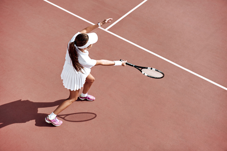 Tennis is her passion. Brunette is completely involved in the game