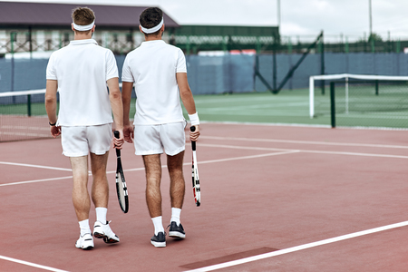 The end of the game. Tennis players leave the court after the match