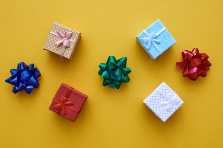 Presents for friends. Small gift boxes with colorful bows