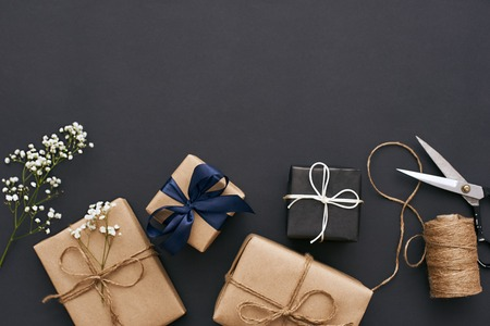 Preparing for holidays. Handmade gift boxes with beautiful decoration for friends