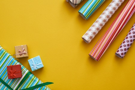 Creative Gift Wrap. Box packaging with bright and colorful gift wrap rolls