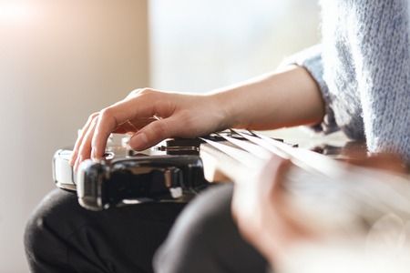 Creativity in focus. Close-up of male hands playing music on electric guitar Stock Photo