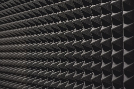 Nobody will hear you. Close up view of a grey soundproof coverage on the wall in music studio. 写真素材