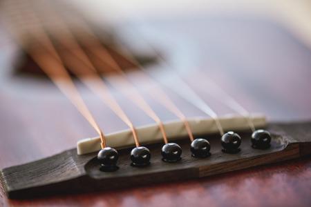 Acoustic guitar. Close-up view of six metal strings. 版權商用圖片