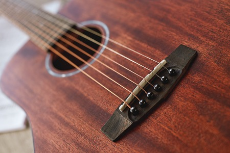 Favourite musical instrument. Close up view of beautiful brown guitar with six metal strings. Music concept 版權商用圖片