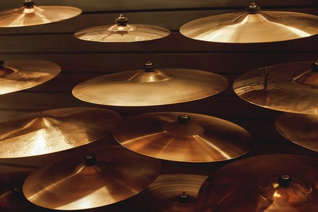 Visiting musical instrument store. Different types of drum cymbals for your ideal drum set. Music concept. Reklamní fotografie